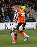 Michael Gardyne fends off Dougie Imrie in the St Mirren v Dundee United Clydesdale Bank Scottish Premier League match played at St Mirren Park, Paisley on 27.10.12.