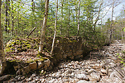 Abutments from a timber trestle at North Fork Junction along the old East Branch & Lincoln Railroad (1893-1948) in the Pemigewasset Wilderness of Lincoln, New Hampshire. This trestle spanned the East Branch of the Pemigewasset River just below the current Thoreau Falls Trail foot bridge.
