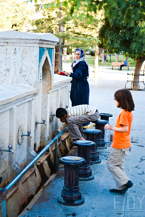 Children drinking water at a fountain in Konya (Anatolia)
