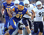 BROOKINGS, SD - AUGUST 31:   Zach Zenner #31 from South Dakota State University breaks loose for a big gain on the opening drive past Butler in the first quarter Saturday evening at Coughlin Alumni Stadium in Brookings. (Photo by Dave Eggen/Inertia)