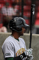 """Lynchburg Hillcats infielder Edward Salcedo #5 """"in the hole"""" waiting to hit during a game against the Carolina Mudcats at Five County Stadium on April 26, 2012 in Zebulon, North Carolina. Carolina defeated Lynchburg by the score of 8-5. (Robert Gurganus/Four Seam Images)"""