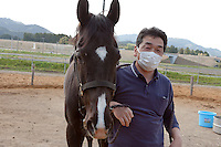 Saito Takahashi training horses in rural Fukushima Minami Soma inside the 30 kilometre exclusion zone created to limit exposure to radiation from the Fukushima Daichi nuclear power plant that was damaged in the March 11th earthquake and tsunami. Fukushima, Wednesday May 4th 2011
