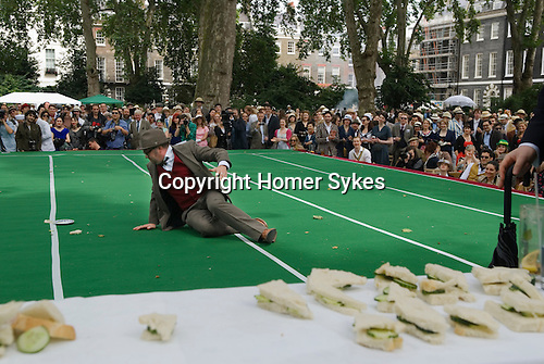 "The Chap Olympiad Bedford Square London UK. The disc cucumber sandwitch throwing competition in the ""Chap Olympiad""."
