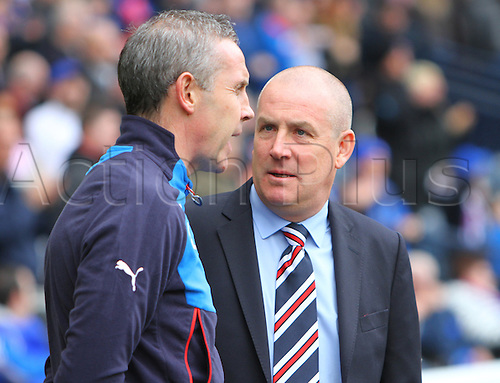 10.04.2016. Hampden Park, Glasgow, Scotland. Petrofac Training Cup Final. Rangers versus Peterhead. Mark Warburton in discussion with assistant David Weir