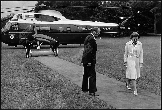 Vice-President (turned President) Gerald Ford, and his wife, after escorting Former President Richard and his wife to a waiting chopper, following Nixon's resignation from the Presidency. Washington, D.C., June 1974