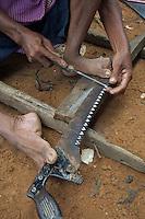 Sharpening his Saw Tonle Sap Lake Village Cambodia