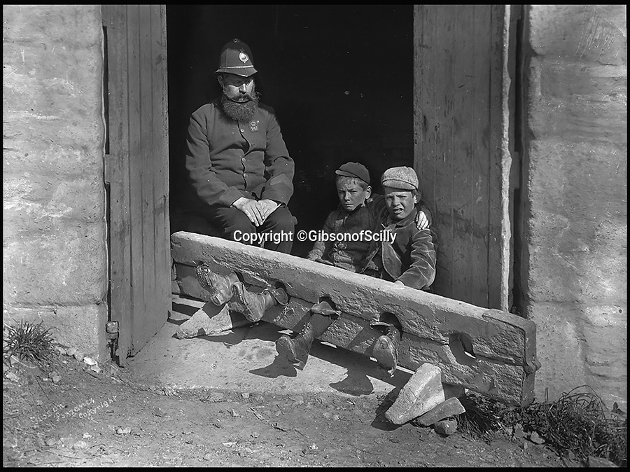 BNPS.co.uk (01202 558833)<br /> Pic: GibsonOfScilly/BNPS<br /> <br /> 1900 - Urchins locked up in the stocks.<br /> <br /> An archive of eye-opening photographs documenting the grim reality of Poldark's Cornwall has emerged for sale for &pound;25,000.<br /> <br /> More than 1,500 black and white images show the gritty lives lived by poverty-stricken families in late 19th and early 20th century Cornwall - around the same time that Winston Graham's famous Poldark novels were set.<br /> <br /> The collection reveals the lowly beginnings of towns like Rock, Fowey, Newquay and St Ives long before they became picture-postcard tourist hotspots.<br /> <br /> Images show young filth-covered children playing barefoot in squalid streets, impoverished families standing around outside the local tax office, and weather-beaten fishwives tending to the day's catch.<br /> <br /> The Cornish archive, comprising 1,200 original photographic prints and 300 glass negative plates, is tipped to fetch &pound;25,000 when it goes under the hammer as one lot at Penzance Auction House.