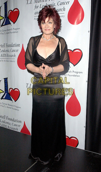 SHARON OSBOURNE.The Annual Bogart Tour for a Cure held at The Kodak Theatre.23/10/2003.palms touching, praying, black silk dress, full lengt, full-length.www.capitalpictures.com.sales@capitalpictures.com.© Capital Pictures