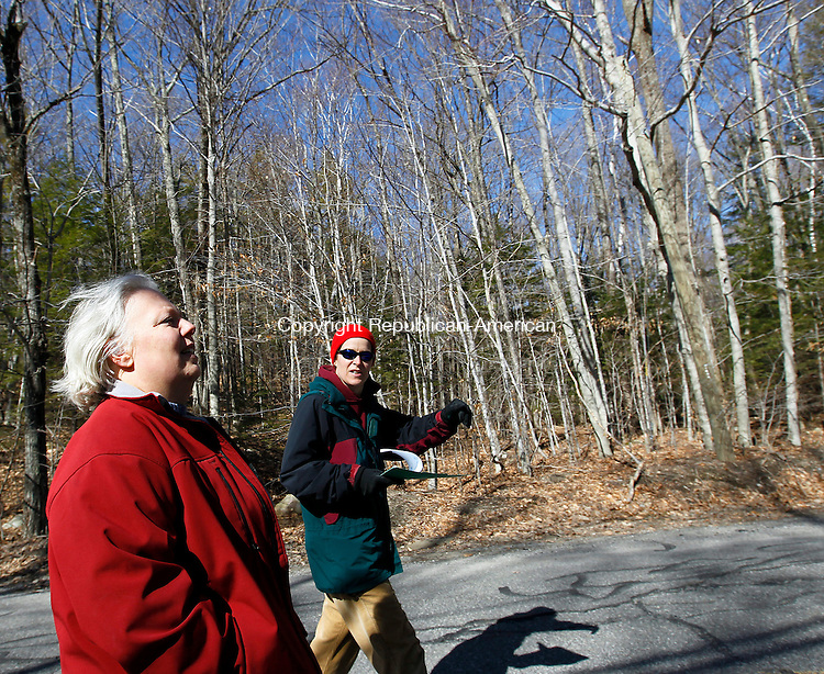 Winsted, CT- 03, April 2011-040311CM05  Winchester Land Trust president, Shelley Harms (left) and vice present, Jen Perga take a walk along East Wakefield Blvd in Winsted Sunday afternoon.  Behind them, is town owned property, which they are looking to protect via restrictive easements.  The controversial subject will be coming before voters at a town meeting this Thursday.  Christopher Massa Republican-American
