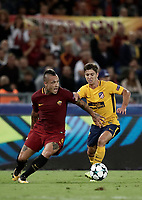 Football Soccer: UEFA Champions League AS Roma vs Atletico Madrid Stadio Olimpico Rome, Italy, September 12, 2017. <br /> Roma's Radja Nainggolan (l) in action with Atletico Madrid's Luciano Vietto (r) during the Uefa Champions League football soccer match between AS Roma and Atletico Madrid at at Rome's Olympic stadium, September 12, 2017.<br /> UPDATE IMAGES PRESS/Isabella Bonotto