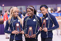 Yanique Haye, Michelle Cumberbatch, and Tamara Keane pause for a photo with their trophies after finishing 2nd, 5th, and 3rd in the 400 meters.