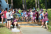Service DAWGS Day: MSU students work on a concrete path at the Sam D. Hamilton Noxubee National Wildlife Refuge as part of MSU's seventh annual Service DAWGS Day. More than 500 student volunteers spent time Tuesday [Aug. 9] volunteering with 35 community partners in the area.<br />