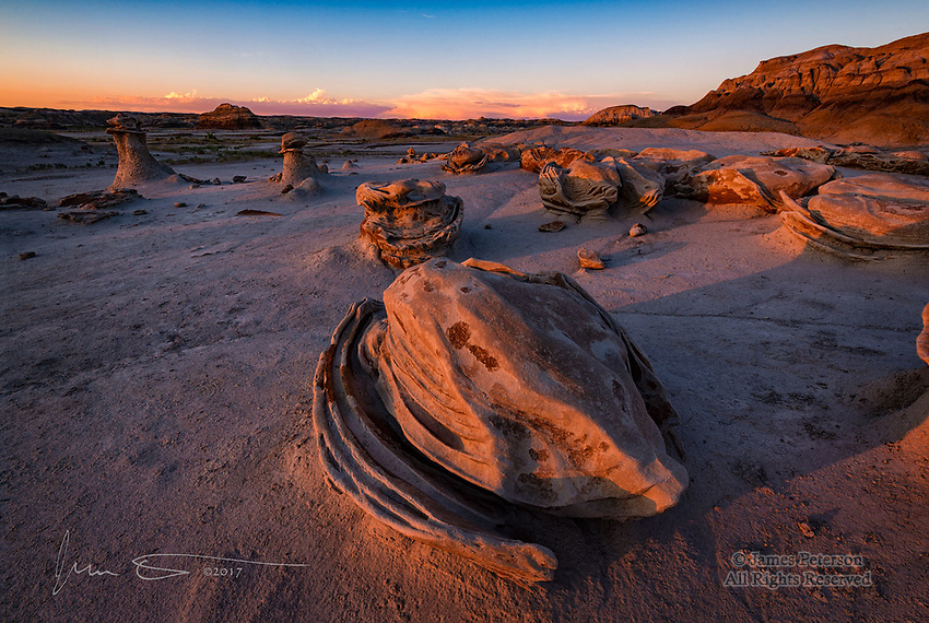 Sunset Light on The Cracked Eggs, Bisti Badlands ©2017 James D Peterson.  Moments before the sun dropped below the Lukachuka Mountains, this scene in New Mexico's Bisti Badlandsi is painted by warm sunset light.