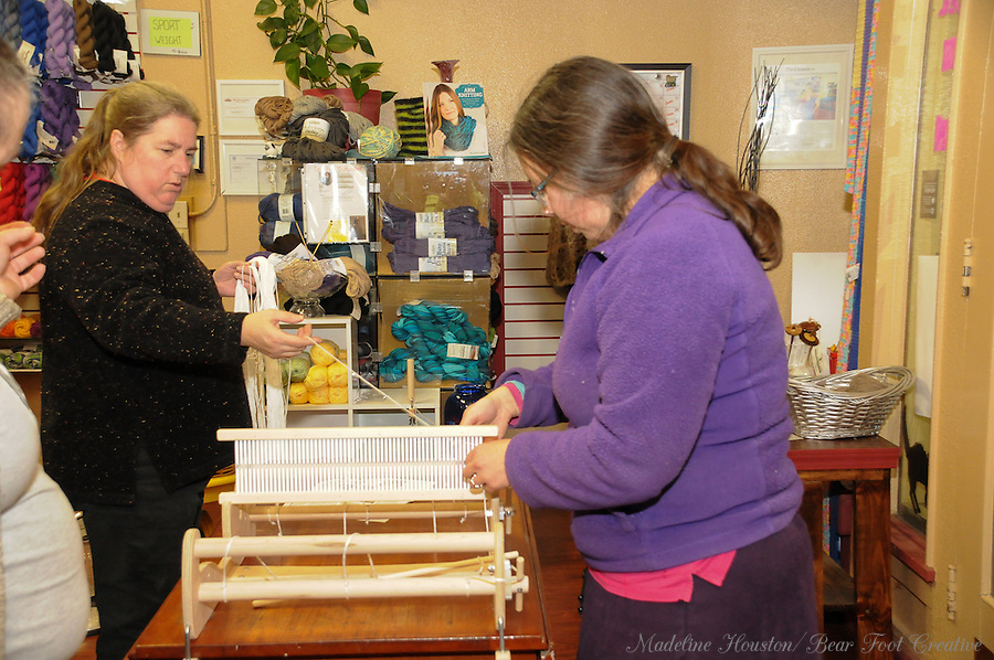 Kelli and Jenn work on a group weaving project at Loose Ends Fiber Arts.<br />
