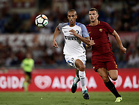 Calcio, Serie A: Roma, stadio Olimpico, 26 agosto, 2017.<br /> Inter's Miranda (l) in action with Roma's Edin Dzeko (r) during the Italian Serie A football match between Roma and Inter at Rome's Olympic stadium, August 26, 2017.<br /> UPDATE IMAGES PRESS/Isabella Bonotto