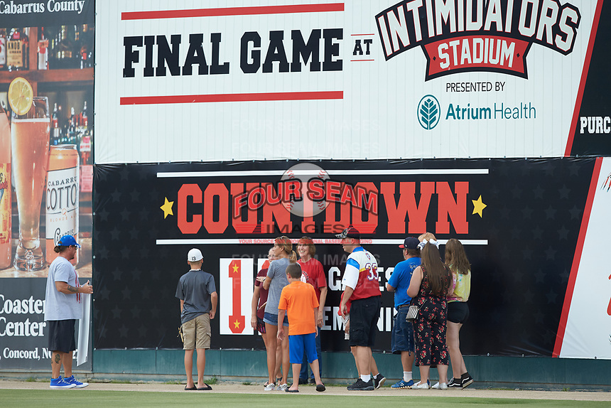 Members of the Kannapolis Intimidators Booster Club help change the sign on the right field wall that counts down the remaining home games at Kannapolis Intimidators Stadium on August 4, 2019 in Kannapolis, North Carolina. The Intimidators will move into a new downtown stadium for the 2020 season. (Brian Westerholt/Four Seam Images)