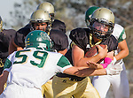 Palos Verdes, CA 10/07/16 - Aidan Kuykendall (Peninsula #7) and Brogan Tyrer (Mira Costa #59) in action during the CIF Bay League game between Mira Costa and Peninsula.