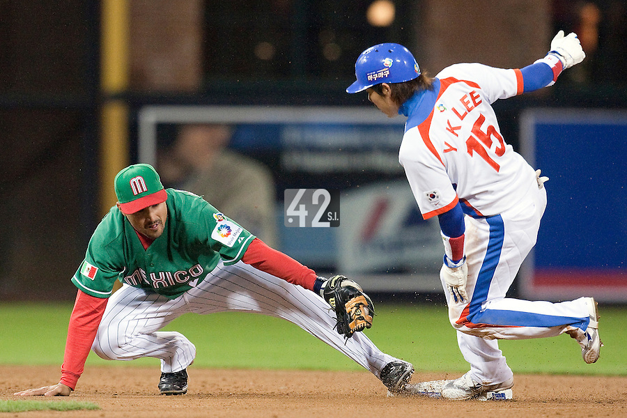 15 March 2009: #15 #15 Yong Kyu Lee of Korea is safe at second base after a slide as #2 Edgar Gonzalez of Mexico stretches for the out during the 2009 World Baseball Classic Pool 1 game 2 at Petco Park in San Diego, California, USA. Korea wins 8-2 over Mexico.