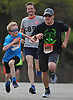 Henrik Kollmeier, 10, of Farmingdale, left, races toward the 5K race finish line with his father Karsten Kollmeier, 44, center, and Jack Manzino, 16, of Dayton, NJ during Long Island Marathon Weekend at Eisenhower Park on Saturday, May 5, 2018.