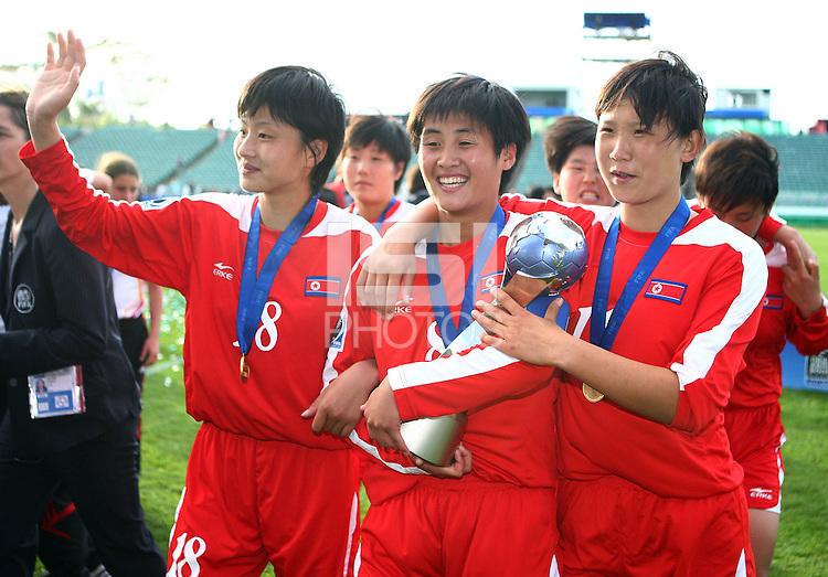 Jubilent Korean DPR players L_R, KIM Un Hyang, PAE Yon Hui and YUN Hyon Hi. USA v Korea Republic. FIFA U-17 Women's World Cup Final. North Harbour Stadium, Auckland, Sunday 16 October 2008. Photo: Simon Watts/PHOTOSPORT