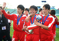 Jubilent Korean DPR players L_R, KIM Un Hyang, PAE Yon Hui and YUN Hyon Hi. USA v Korea Republic. FIFA U-17 Women's World Cup Final. North Harbour Stadium, Auckland, Sunday 16 October 2008. Photo: Simon Watts/PHOTOSPORT