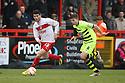 Dani Lopez of Stevenage escapes from Ed Upson of Yeovil. Stevenage v Yeovil Town- npower League 1 -  Lamex Stadium, Stevenage - 13th April, 2013. © Kevin Coleman 2013.. . . . .. . . .  . . .  .