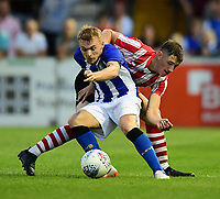 Lincoln City trialist vies for possession with Sheffield Wednesday's Fraser Preston<br /> <br /> Photographer Chris Vaughan/CameraSport<br /> <br /> Football Pre-Season Friendly - Lincoln City v Sheffield Wednesday - Friday 13th July 2018 - Sincil Bank - Lincoln<br /> <br /> World Copyright &copy; 2018 CameraSport. All rights reserved. 43 Linden Ave. Countesthorpe. Leicester. England. LE8 5PG - Tel: +44 (0) 116 277 4147 - admin@camerasport.com - www.camerasport.com