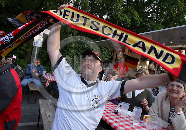 BERLIN, GERMANY - 7. MAY 2006 -- More then 10 000 people took part in the opening party of  the FIFA Soccer World Championship 2006 that was held in front of Berlin's Brandenburger Tor. In picture: A football fan with the German flag. . -- PHOTO: UFFE NOEJGAARD / EUP-IMAGES