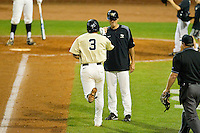 Carlos Lopez #3 of the Wake Forest Demon Deacons fist bumps with head coach Tom Walter #32 as he rounds third base after hitting a solo home run against the Miami Hurricanes during Game Nine of the 2012 ACC Baseball Championship at NewBridge Bank Park on May 25, 2012 in Winston-Salem, North Carolina.  The Hurricanes defeated the Demon Deacons 6-3.  (Brian Westerholt/Four Seam Images)