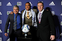 The Kansas City Wizards first pick and fourth overall Teal Bunbury (University of Akron) with assistant coach Octavio Zambrano (L), and technical director and manager Peter Vermes (R) during the MLS SuperDraft at the Pennsylvania Convention Center in Philadelphia, PA, on January 14, 2010.