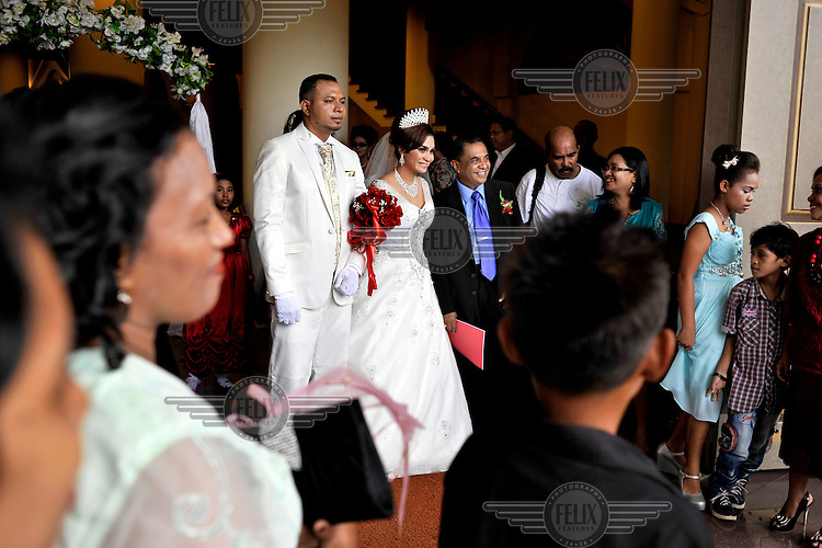 Wedding couple emerge from the main cathedral. The 1999-2002 religious war between Maluku's Christian and Muslim populations, mainly centred on Ambon Island, led to over 5000 deaths and to around 500,000 people become displaced. Destroyed homes and offices, churches and mosques are slowly being either torn-down or renovated.  Urban centres, such as Ambon City, continue to be split along largely sectarian lines, and tensions are never far below the surface. Riots between Christian and Muslim youths erupted in September 2011 and, most recently, June 2012, though luckily simmered down just as quickly, partly due to community leaders learning how to defuse tensions from the earlier, more devastating, conflagration. /Felix Features