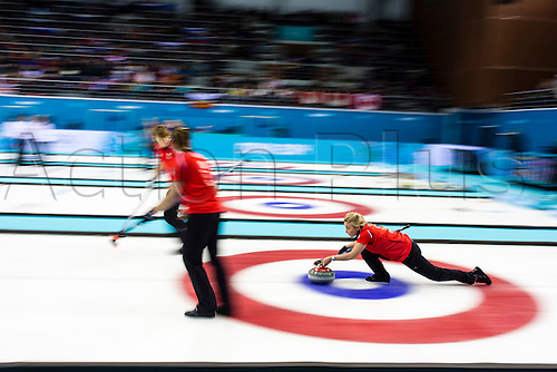 19.02.2014 Sochi, Krasnodar Krai, Russia.   Great Britain vice-skip Anna SLOAN delivers a stone during the semifinal of the Women's Curling competition between Great Britain and Canada from the Ice Cube Curling Centre, Coastal Clustre - XXII Olympic Winter Games