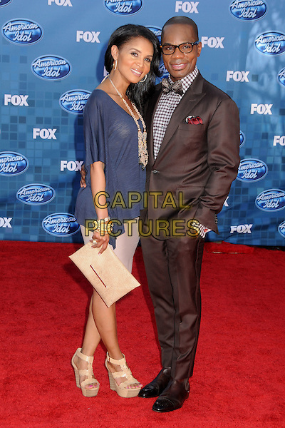 "GUEST & KIRK FRANKLIN.""American Idol 2011"" Finale - Arrivals held at Nokia Theatre LA Live, Los Angeles, California, USA..May 25th, 2011.full length blue dress suit hand in pocket black grey gray check glasses bow tie shirt.CAP/ADM/BP.©Byron Purvis/AdMedia/Capital Pictures."