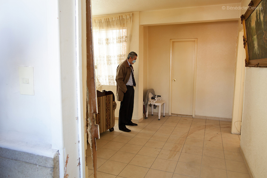 "Donovan inspects the scene before carrying out a forensic cleaning in Mexico City, Mexico on January 14, 2016. The decomposed body of a man in his 50s was found on the floor of his mother's bedroom, days after he had died of an intestinal obstruction. Because of her physical disability, the mother of the deceased – who had been her caregiver – was unable to move enough to make an emergency call. As a consequence, she was trapped in the room for three days with the body of her son – and without food or water - before help arrived. Donovan Tavera, 43, is the director of ""Limpieza Forense México"", the country's first and so far the only government-accredited forensic cleaning company. Since 2000, Tavera, a self-taught forensic technician, and his family have offered services to clean up homicides, unattended death, suicides, the homes of compulsive hoarders and houses destroyed by fire or flooding. Despite rising violence that has left 70,000 people dead and 23,000 disappeared since 2006, Mexico has only one certified forensic cleaner. As a consequence, the biological hazards associated with crime scenes are going unchecked all around the country. Photo by Bénédicte Desrus"