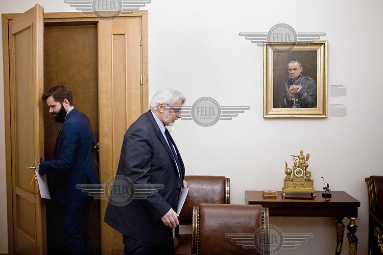 Foreign affairs minister Witold Waszczykowski with his press spokesman Jakub Wawrzyniak at his office beside a portrait of Jozef Pilsudski.