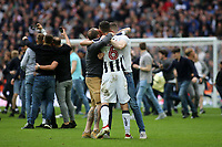 Millwall fans celebrate on the pitch at the final whistle with Millwall's Shaun Williams during Bradford City vs Millwall, Sky Bet EFL League 1 Play-Off Final at Wembley Stadium on 20th May 2017