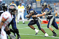 27 November 2010:  FIU running back Darriet Perry (28) carries the ball for a touchdown with 7:11 remaining in the second quarter as the FIU Golden Panthers defeated the Arkansas State Red Wolves, 31-24, at FIU Stadium in Miami, Florida.