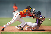 San Francisco Giants Kevin Rivera (2) lunges for a throw as Tyler Bugner (67) slides into second base during an Instructional League game against the Colorado Rockies on October 8, 2016 at the Giants Baseball Complex in Scottsdale, Arizona.  (Mike Janes/Four Seam Images)