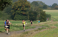 28 SEP 2014 - STOWMARKET, GBR - Competitors make their way round the 5km run course during the 2014 West Suffolk Triathlon in Stowmarket in Suffolk, Great Britain (PHOTO COPYRIGHT © 2014 NIGEL FARROW, ALL RIGHTS RESERVED)