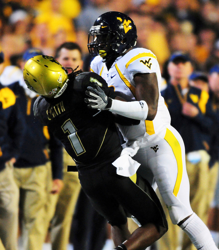 18 September 08: West Virginia defensive back Quinten Andrew stops Colorado kickoff returner Josh Smith.  The Colorado Buffaloes defeated the West Virginia Mountaineers 17-14 in overtime at Folsom Field in Boulder, Colorado. For Editorial Use Only.