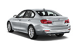 Car pictures of rear three quarter view of 2018 BMW 3-Series 320i 4 Door Sedan Angular Rear
