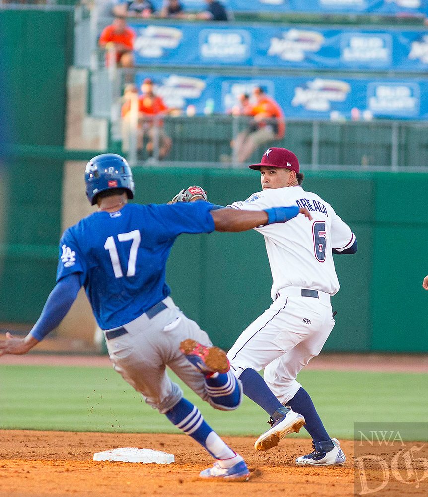 Tulsa Drillers vs NWA Naturals Baseball Shortstop Humberto Arteaga turns the double play, as Henry Ramos slides in trying to break it up at Arvest Ballpark, Springdale, AR, Wednesday, July 12, 2017,  © 2017 David Beach