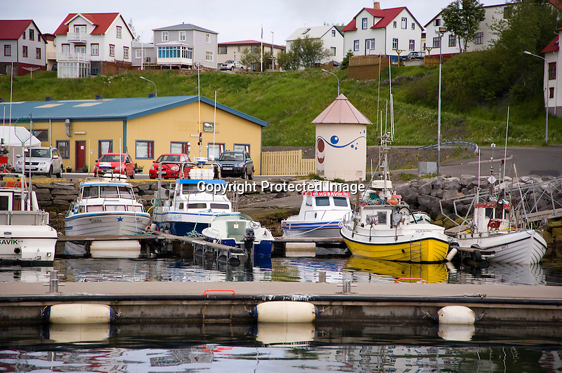 View of Harbor and Homes in Husavik in North Iceland