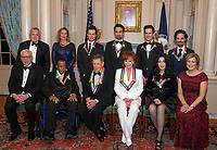The recipients of the 41st Annual Kennedy Center Honors pose for a group photo following a dinner hosted by United States Deputy Secretary of State John J. Sullivan in their honor at the US Department of State in Washington, D.C. on Saturday, December 1, 2018.  From left to right back row: Deputy Secretary of State Sullivan, Grace Rodriguez, Thomas Kail, Lin-Manuel Miranda, Andy Blankenbuehler, Alex Lacamoire. Front row, left to right:  David M. Rubenstein, Wayne Shorter, Philip Glass, Reba McEntire, Cher, and Deborah F. Rutter.  The 2018 honorees are: singer and actress Cher; composer and pianist Philip Glass; Country music entertainer Reba McEntire; and jazz saxophonist and composer Wayne Shorter. This year, the co-creators of Hamilton,? writer and actor Lin-Manuel Miranda; director Thomas Kail; choreographer Andy Blankenbuehler; and music director Alex Lacamoire will receive a unique Kennedy Center Honors as trailblazing creators of a transformative work that defies category.<br /> CAP/MPI/RS<br /> &copy;RS/MPI/Capital Pictures