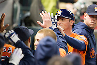 Houston Astros outfielder Rick Ankiel (28) is greeted in the dugout after scoring in the seventh inning of the MLB baseball game against the Detroit Tigers on May 3, 2013 at Minute Maid Park in Houston, Texas. Detroit defeated Houston 4-3. (Andrew Woolley/Four Seam Images).