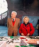 ITALY, Venice, local senior couple shopping at the Rialto Fish Market.