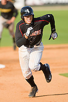 Trayce Thompson #24 of the Kannapolis Intimidators heads for third base against the West Virginia Power at Fieldcrest Cannon Stadium April 25, 2010, in Kannapolis, North Carolina.  Photo by Brian Westerholt / Four Seam Images