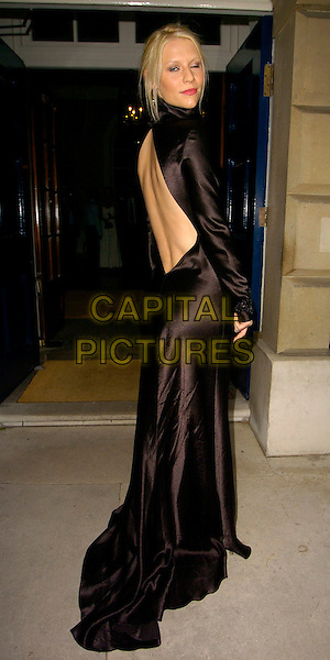 CLAIRE DANES.The Ralph Lauren Wimbledon Championships Dinner, Spencer House, London, UK..June 21st, 2006.Ref: CAN.full length black satin dress gown high collar long sleeves backless back behind rear looking over shoulder.www.capitalpictures.com.sales@capitalpictures.com.©Capital Pictures