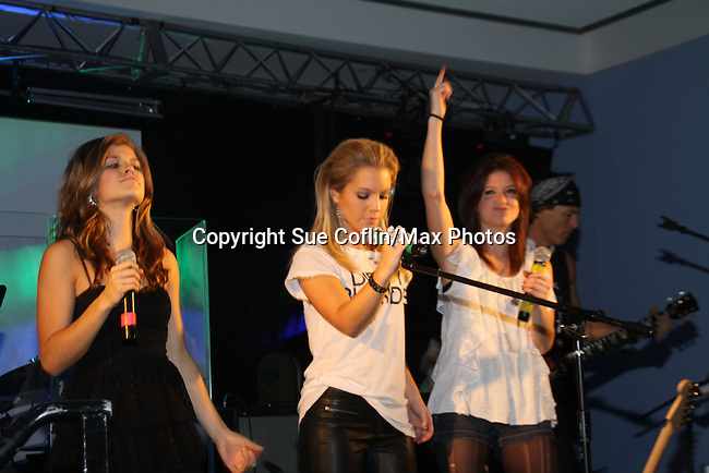 "Hosted by OLTL Gina Tognoni and featuring the Bradley Cole Band at the 9th Annual Rock Show for Charity to benefit the American Red Cross of Greater New York on October 9, 2010 at the American Red Cross Headquarters, New York City, New York. Also singing were Kristen Alderson (We Belong) followed by Kelley Missal, Kristen Alderson and Brittany Underwood (I Love Rock N'Roll), Brittany Underwood ""Life Is A Highway"", Kim Zimmer ""If You Don't Know Me By Now"" and ""Simply The Best"", David Gregory ""I'm Gonna Be"", Jason Tam ""Power of Love"" and ""Jessie's Girl"", Sandra Santiago ""Landslide"" and ""Gloria"". For Guiding Light - Bradley Cole ""I Ran"", ""White Wedding"" and ending with ""Pride and Joy"", Karla Mosley ""I Wanna Dance"" and ""Ben"". Items were auctioned off and many dollars were raised. (Photos by Sue Coflin/Max Photos)"