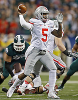 Ohio State Buckeyes quarterback Braxton Miller (5) drops back to pass against Michigan State Spartans in the 1st quarter during the Big 10 Championship game at Lucas Oil Stadium in Indianapolis, Ind on December 7, 2013.  (Dispatch photo by Kyle Robertson)